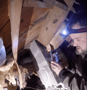 Shane inspecting crawlspace