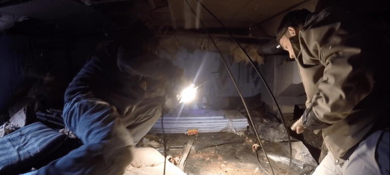 Home owner attending crawlspace inspection