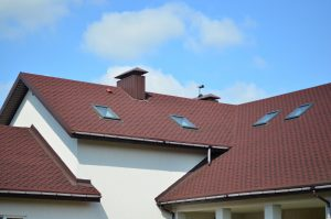 Roofing shingles red with skylights