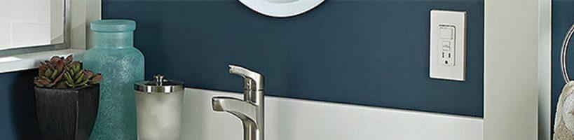 Inspecting GFI near bathroom sink